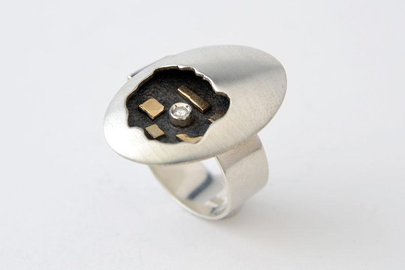 Anillo de Plata Oro y un Diamante